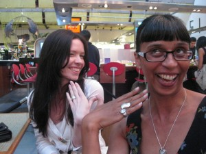 Liz (background) wears the Gravity ring while Sharon wears my Gravity engagement ring with her OWN Diana ring.