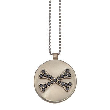 This locket in 18K white gold and black diamonds opens up to reveal ....