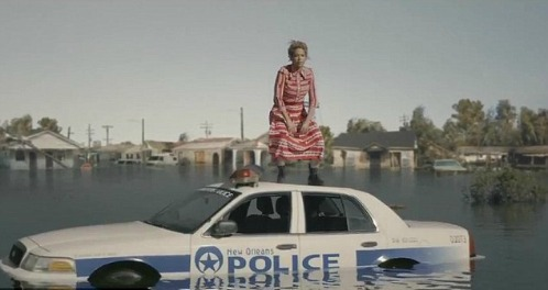Beyonce on a sinking New Orleans cop car.