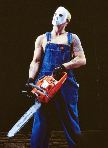 I think Eminem looks way scarier with the chainsaw than he would with the machete.
